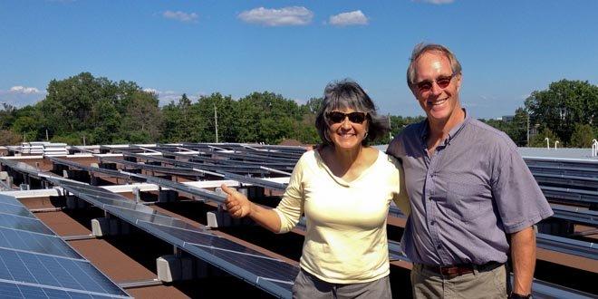 OREC Members standing in front of solar panels