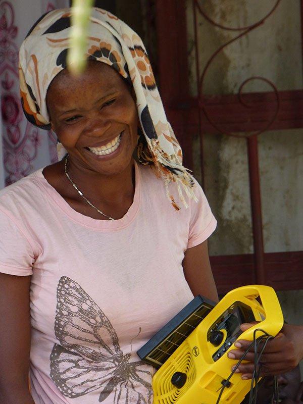 Tanzanian farmer displays FRI radio